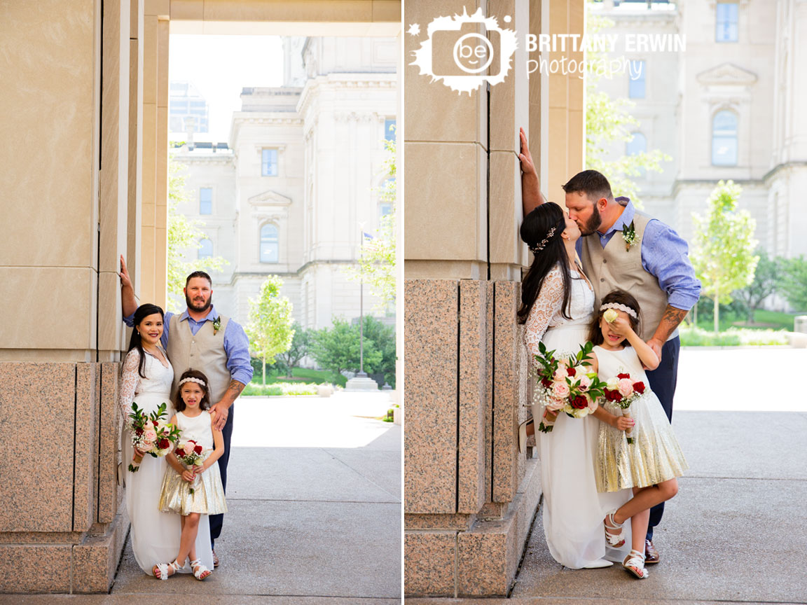 Indianapolis-elopement-photographer-couple-kiss-by-state-house-daughter-cover-eyes.jpg
