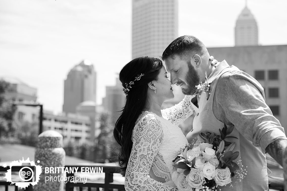 Downtown-Indianapolis-elopement-photographer-couple-with-skyline-on-canal.jpg