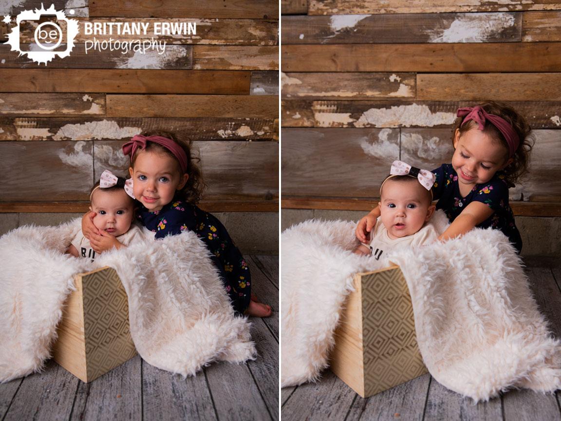 Indianapolis-portrait-photographer-sisters-hug-milestone.jpg