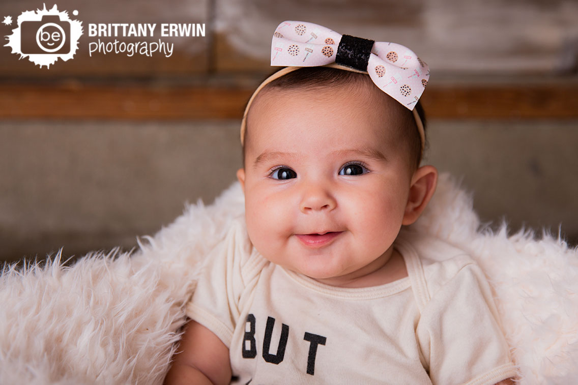 baby-girl-milk-cookies-bow-milestone-portrait.jpg