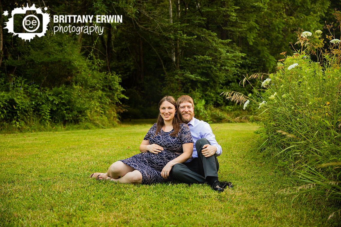 maternity-portrait-photographer-outside-summer-couple-in-grass-country-setting.jpg