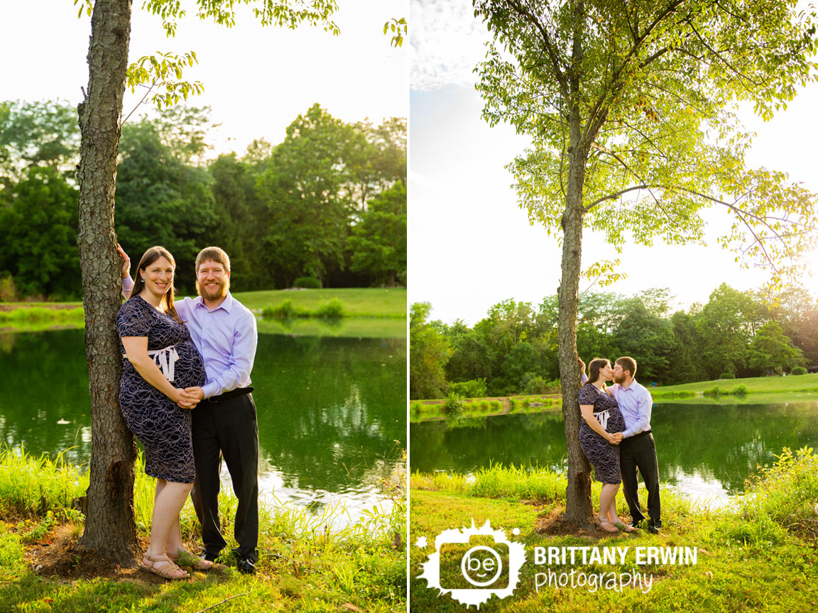Indianapolis-sunset-maternity-portrait-session-couple-by-pond-with-tree-reflection.jpg