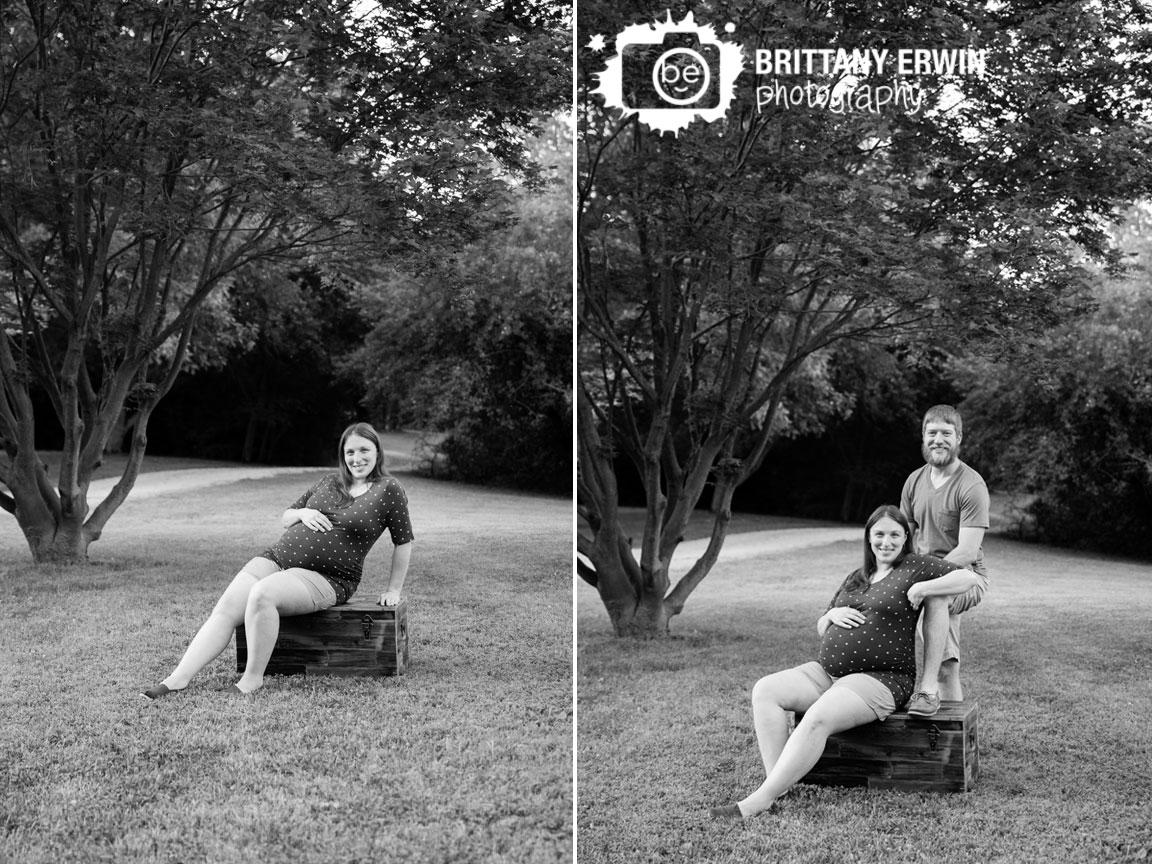 Maternity-portrait-outside-summer-path-under-japanese-maple-tree-couple-on-wooden-trunk.jpg