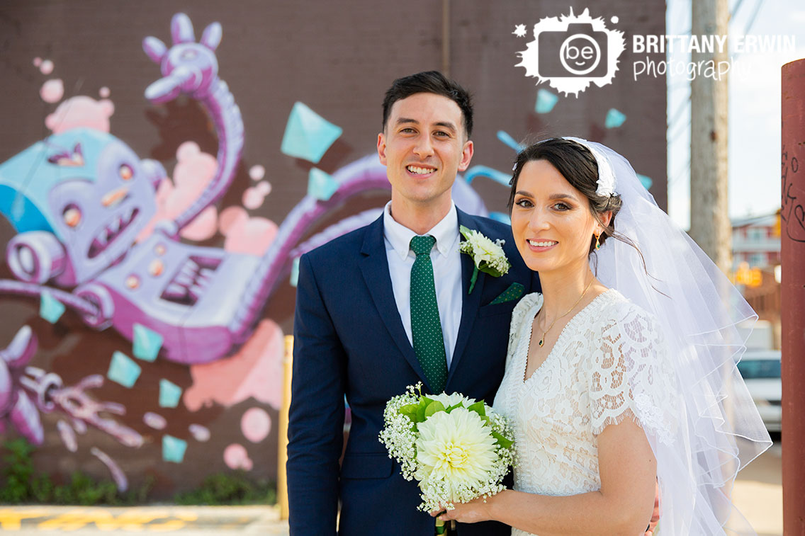 Fountain-Square-Indiana-wedding-photographer-couple-with-mural-robot-painting.jpg