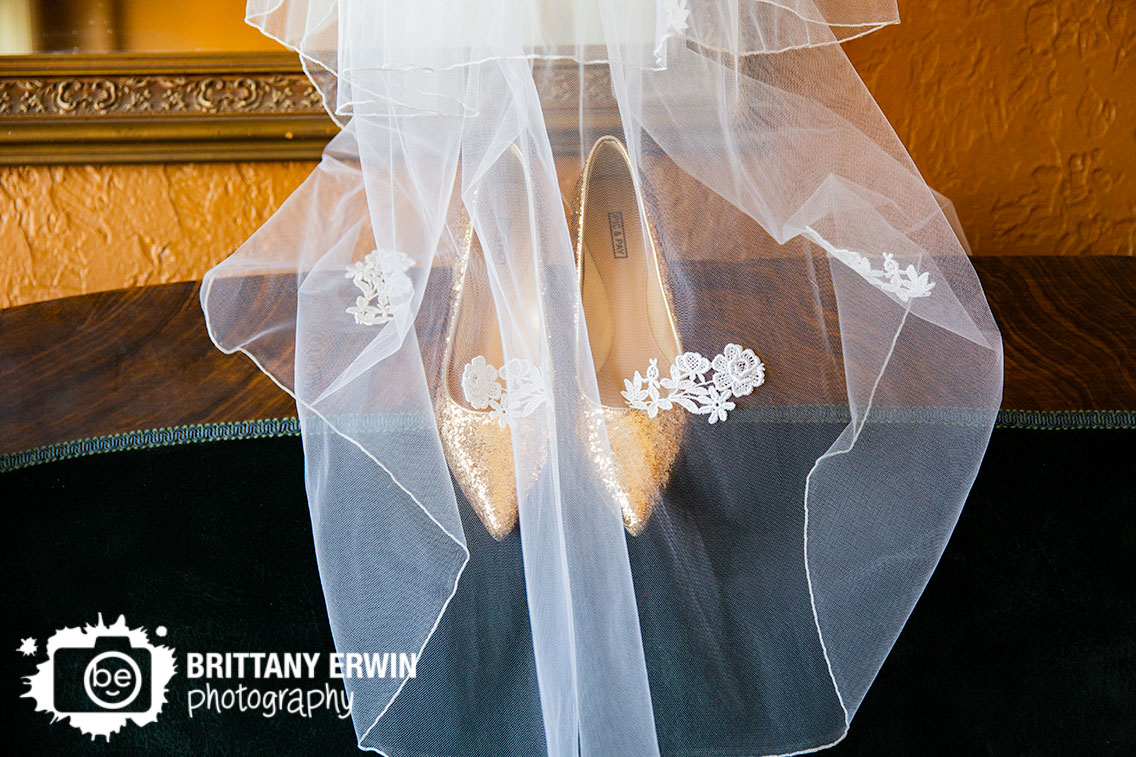 Indiana-wedding-photographer-veil-over-gold-shimmer-shoes-pick-and-pay-heels-on-couch.jpg