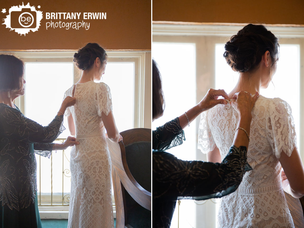 Fountain-Square-Theatre-bride-getting-ready-mother-zipping-up-lace-dress-back.jpg