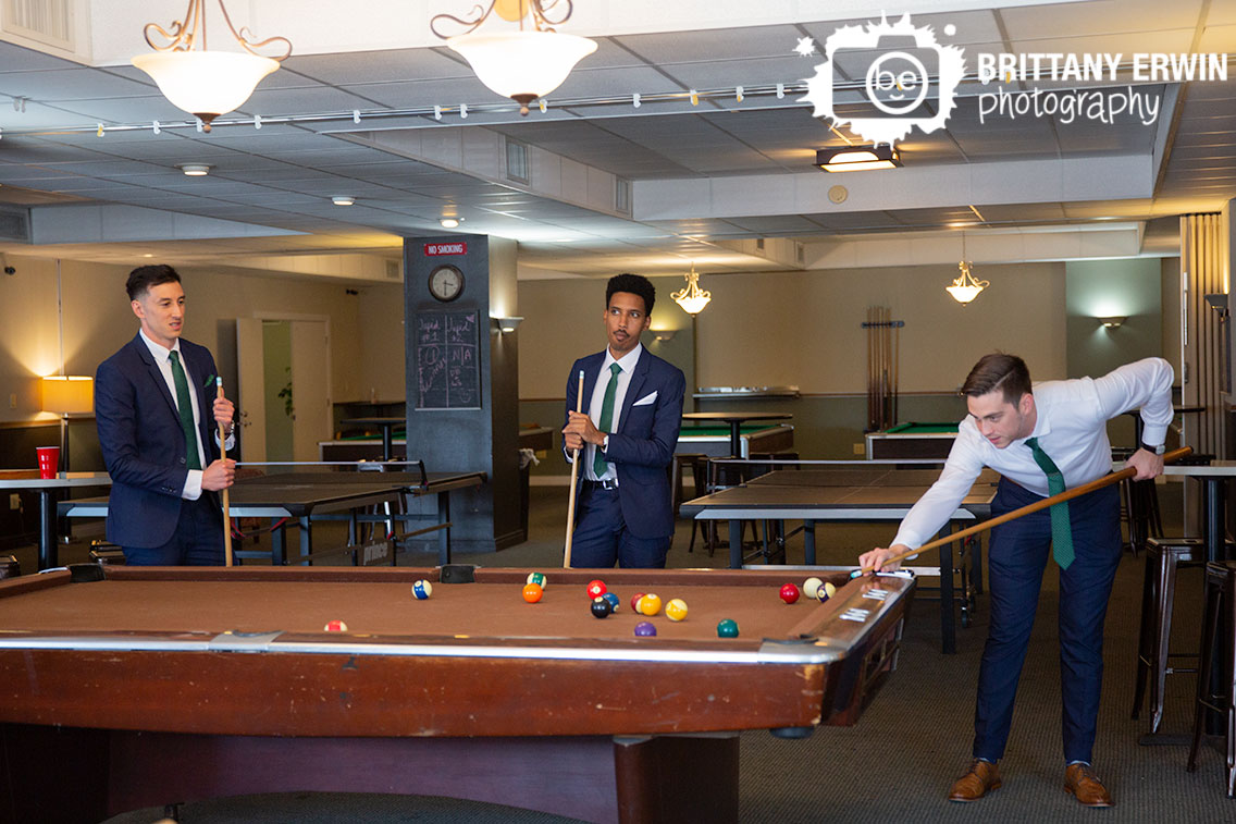 Groom-groomsmen-playing-pool-at-Fountain-Square-Theatre-before-wedding.jpg