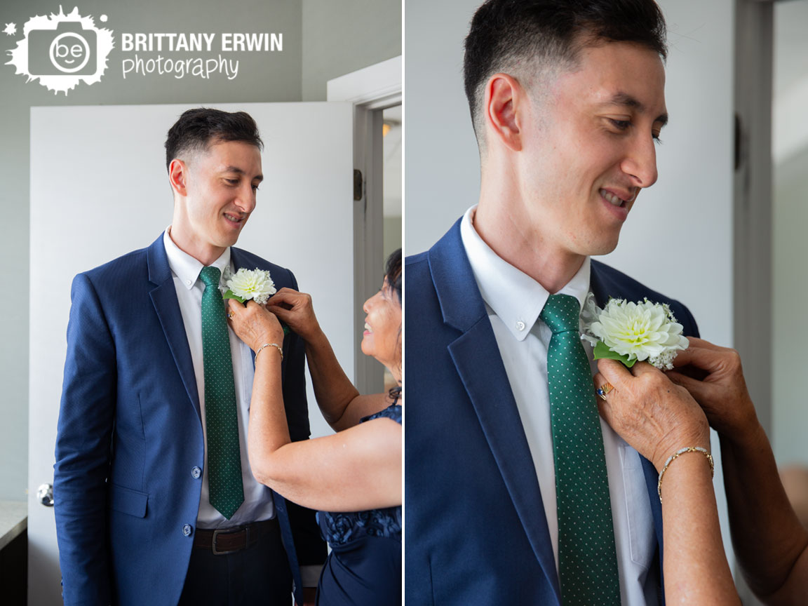 Fountain-Square-Indiana-wedding-photographer-groom-boutonniere-pinned-on-by-mother.jpg