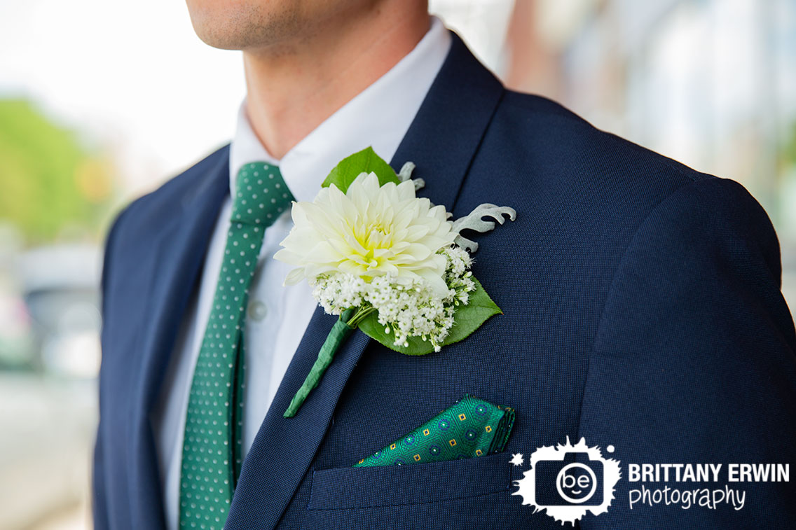 Fountain-Square-Indiana-wedding-photographer-groom-suit-green-tie-daliah-boutonniere.jpg