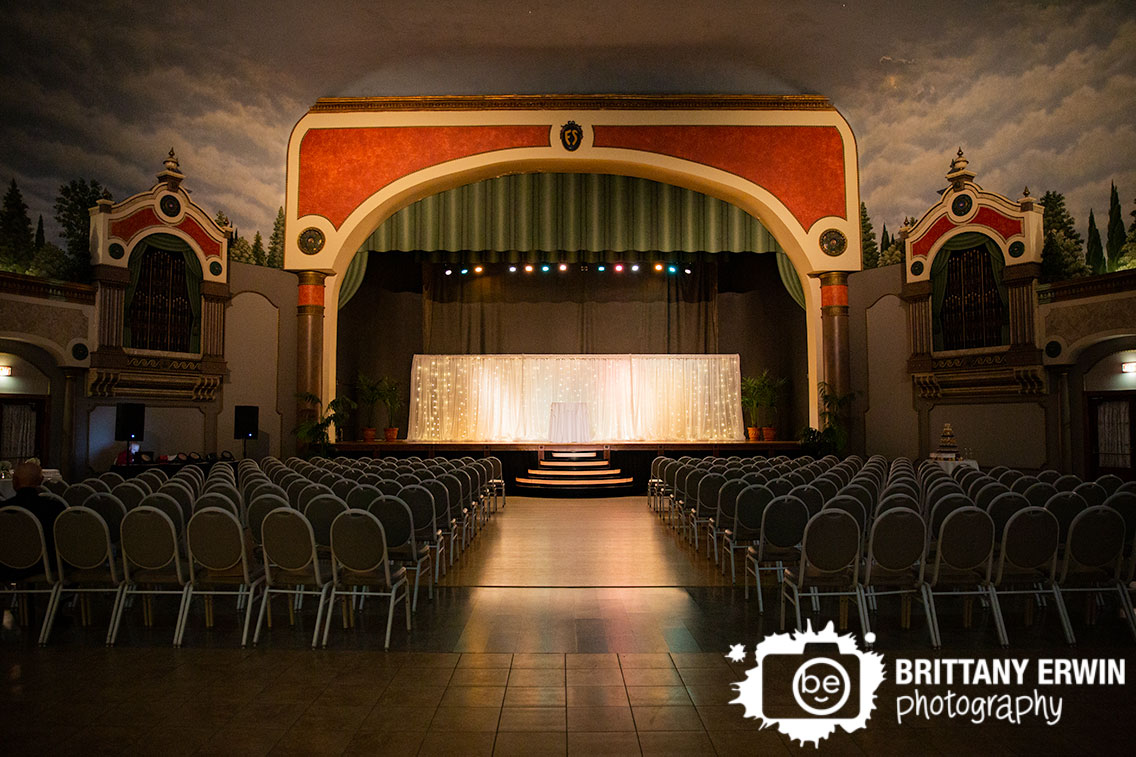 Fountain-Square-Theatre-wedding-ceremony-setup-stage-spot-light-twinkle-lights-curtain.jpg