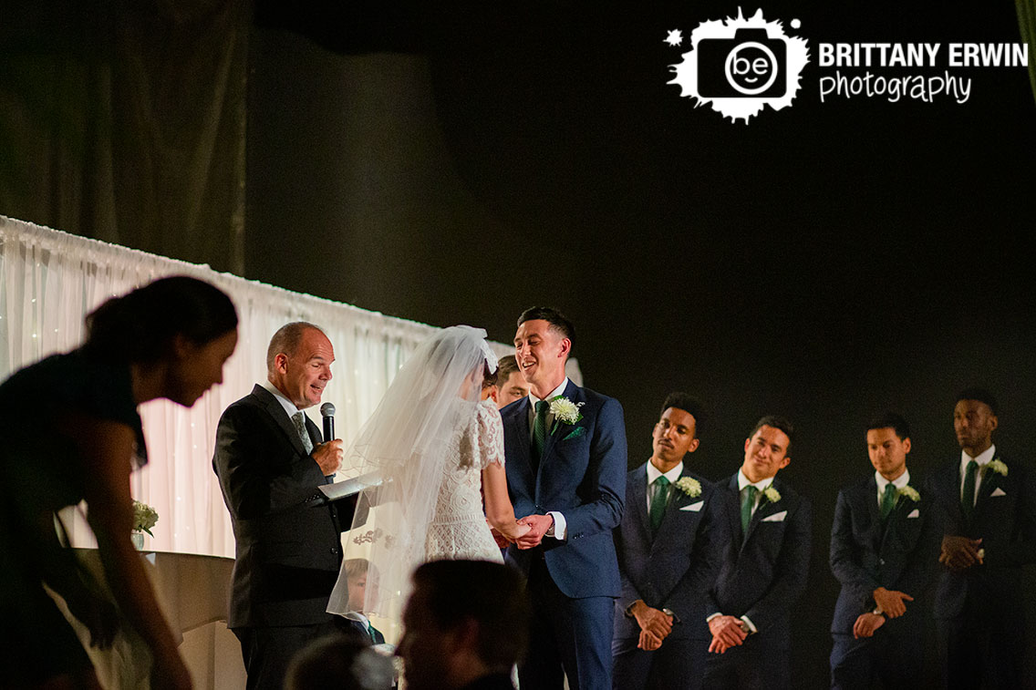 Wedding-ceremony-groom-laughing-at-altar-on-stage.jpg
