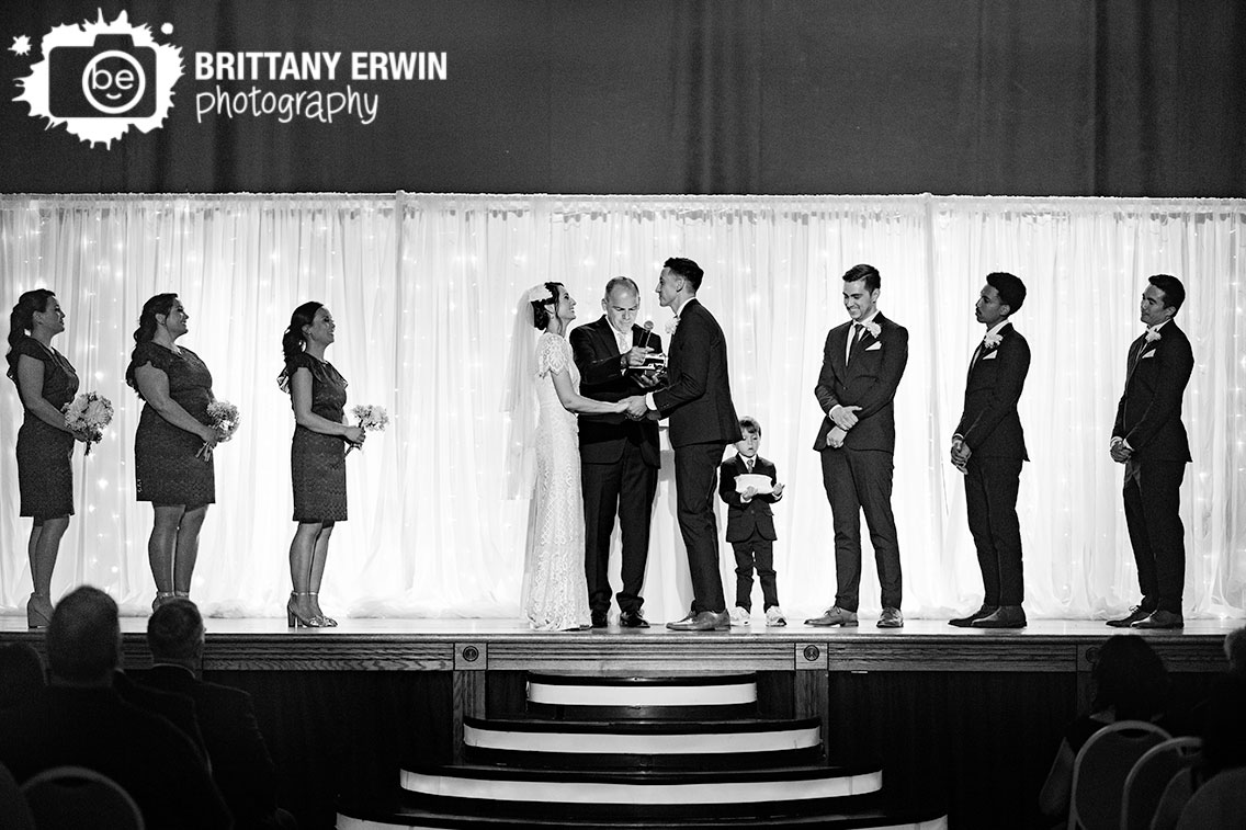 Wedding-ceremony-photographer-bride-laughing-reaction-vows-on-stage.jpg