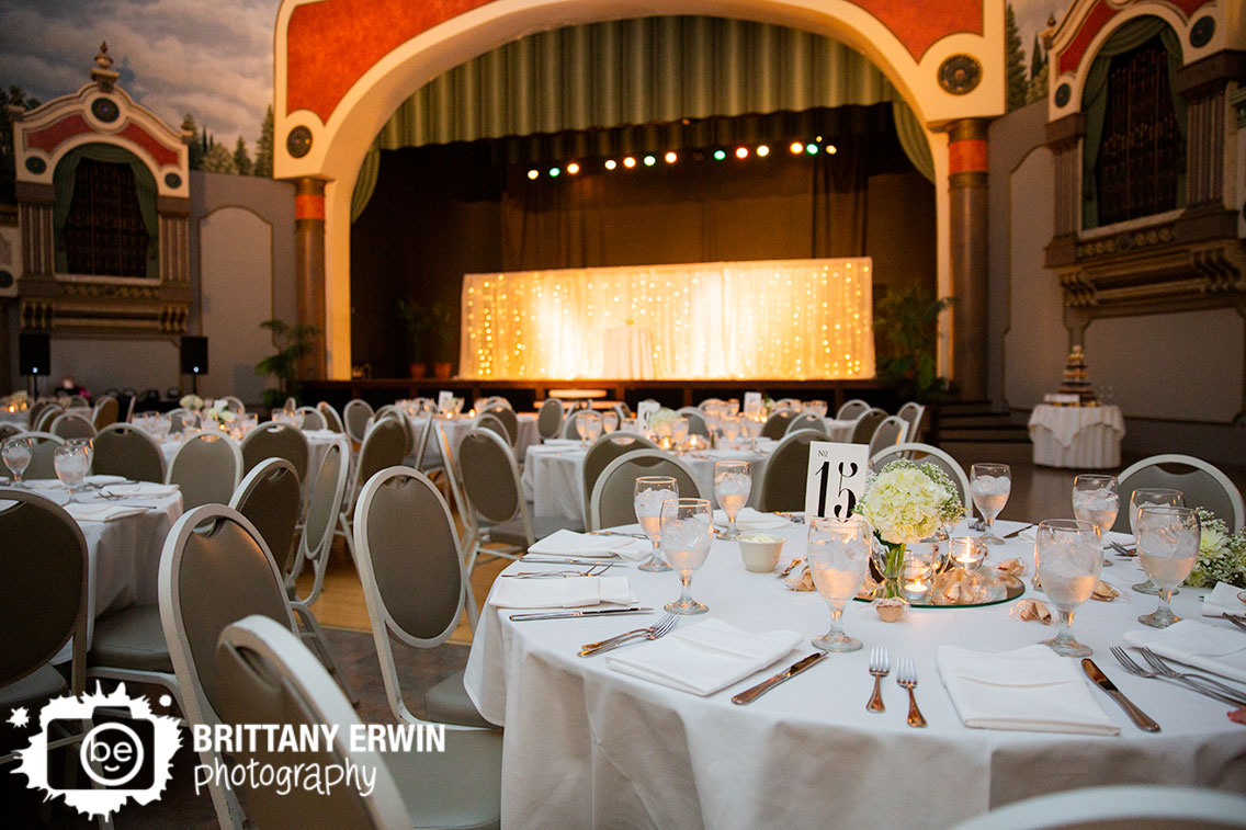 Fountain-Square-Theater-wedding-reception-space-stage-twinkle-lights-flower-centerpiece.jpg