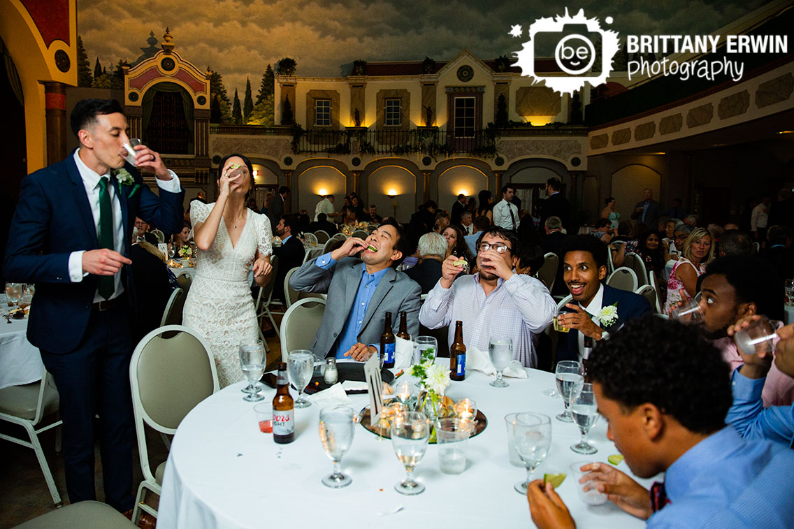 Wedding-reception-couple-at-table-shots-tequila-lime.jpg