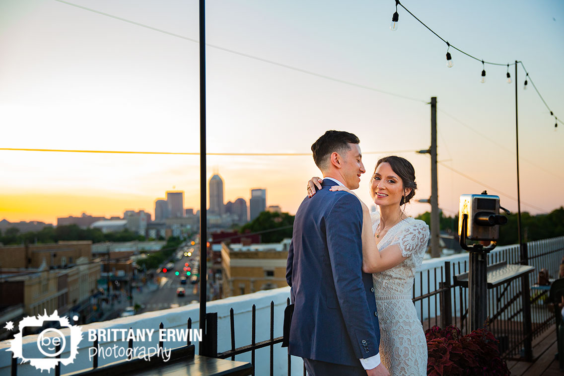 Fountain-Square-Theater-wedding-photographer-rooftop-skyline-view-at-sunset-bridal-couple.jpg