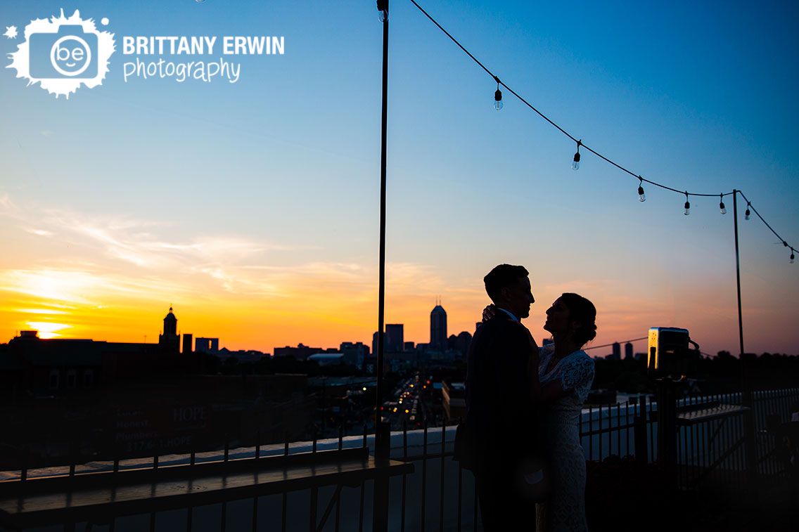 Fountain-Square-Theater-wedding-photographer-roof-top-couple-skyline-sunset-golden-hour-silhouette-Indianapolis.jpg