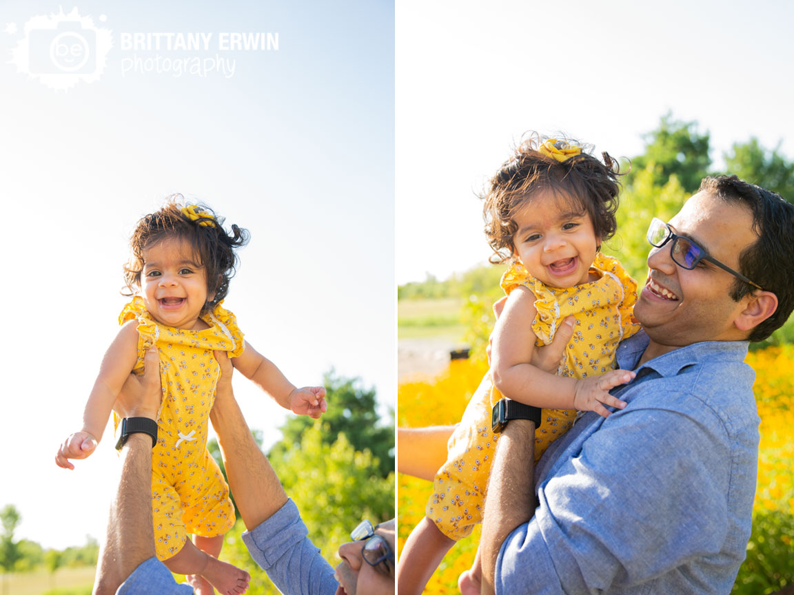 milestone-portrait-photographer-baby-girl-playing-with-dad-up-in-air.jpg