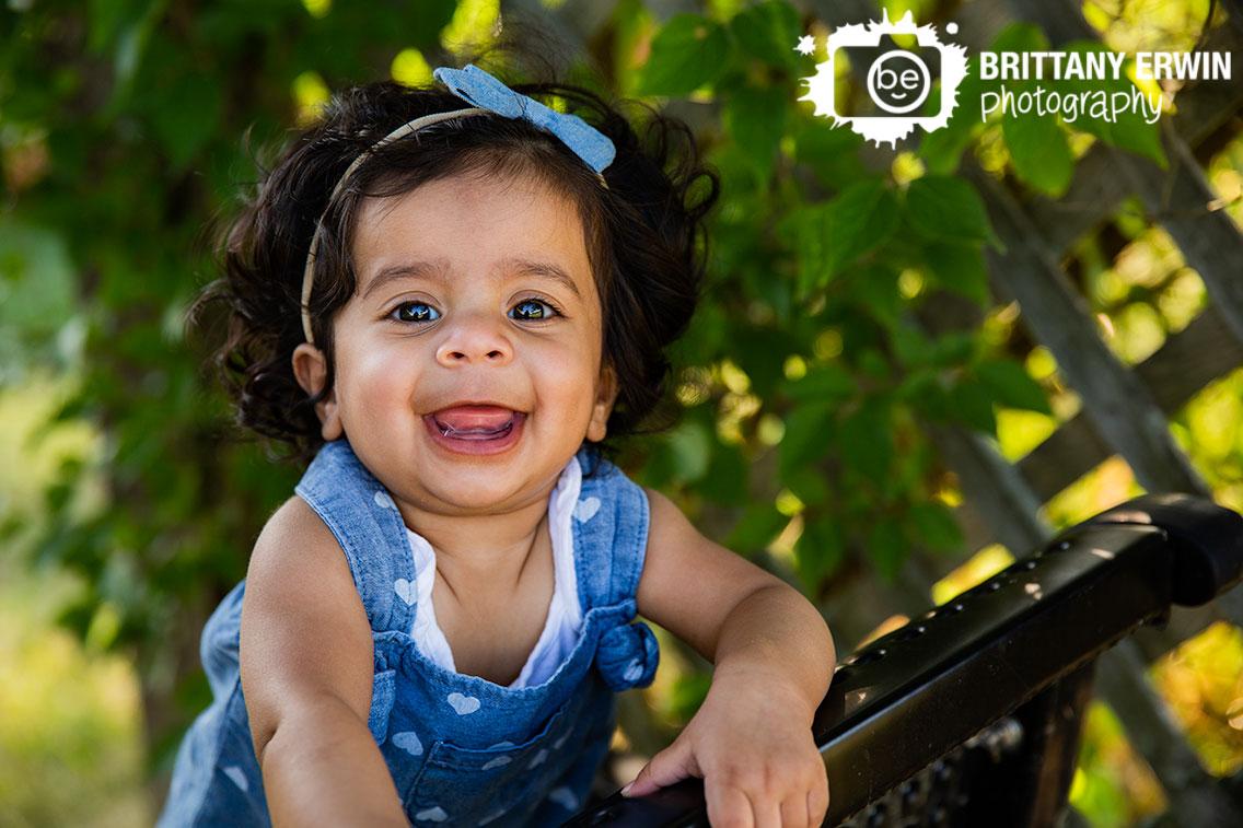 Coxhall-Gardens-milestone-session-baby-girl-smile-happy-denim-bow-with-ivy.jpg