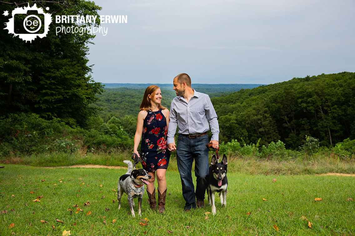 Couple-walking-with-dogs-holding-hands-at-hesitation-point.jpg