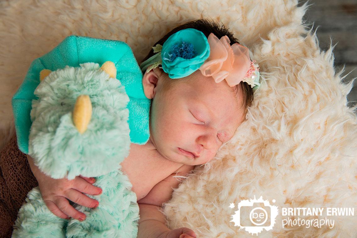 dinosaur-stuffie-stuffed-animal-newborn-baby-girl-sleeping-flower-tieback.jpg