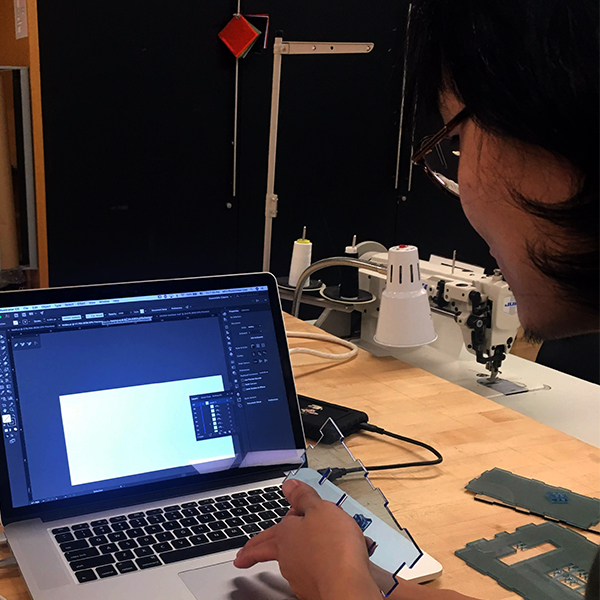 Lili Zhang from  MFA Photo, Video, and Related Media  works on a laser cutter file for an assignment for the Photo, Video, and Related Media class taught by former VFL Staff member Tak Cheung.