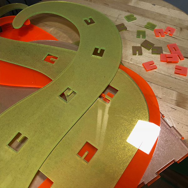 To do this project, he learned how to use the UV Printer as well as the laser cutter.