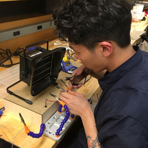 Jeong was in the shop today working on his next project for his  MFA Photo, Video, and Related Media  class. He is soldering together strips of LEDs and using them to populate the back wall of a series of stackable lightboxes.