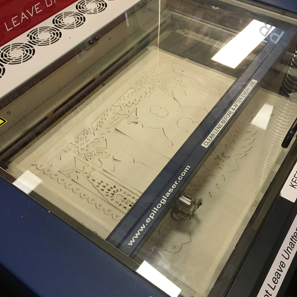 Through trial and error Katherine was able to set machines to cut the detailed line work completely and efficiently.