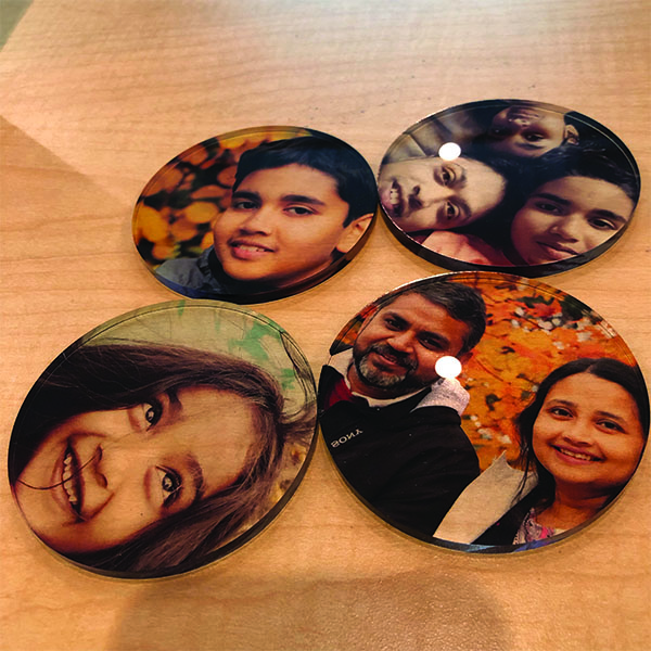 Student staff workers exploring the Laser Cutter and UV printer to make Thanksgiving gifts.  Abhinav from  MFA Interaction Design  made these coasters to give to his family members on Thanksgiving.