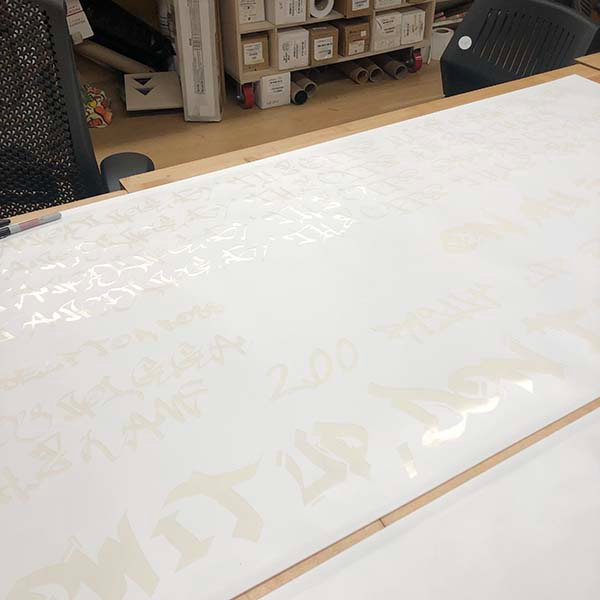 Juan Bravo, a  MFA Fine Arts  2nd year student came in today to use our Roland vinyl printer and cutter. He printed a stencil of hip hop lyrics and is meticulously removing the negatives for a piece that he will be presenting in the department open studio.