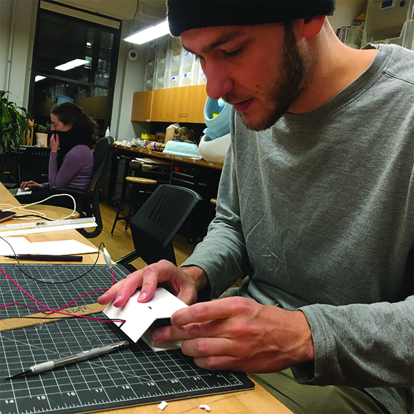 MFA  Products of Design  First Year student and VFL Student worker Weston Rivell is working on a case for his Arduino prototype using matboard.