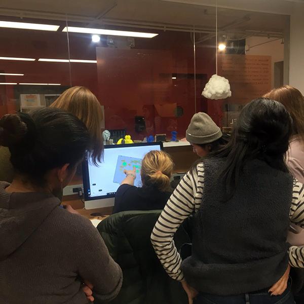 VFL staff member Oya Kosebay helps  Master of Arts in Teaching  students set up their 3D print jobs.