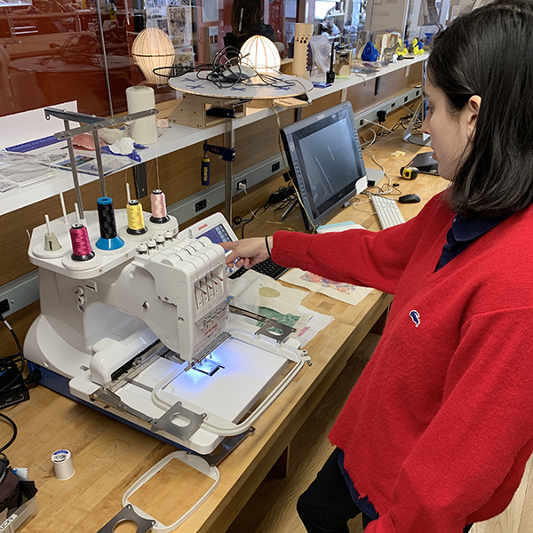 Pictured here is lab manager  Maya Ragazzo  giving a demo on the VFL's embroidery machine. The embroidery machine is capable of reading and embroidering vector graphics saved as EPS files.