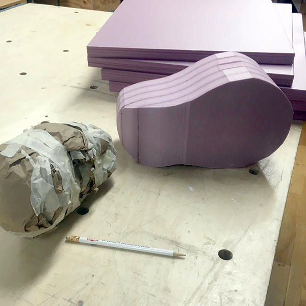 Her purple foam blobs are on their way to becoming fake fetuses.