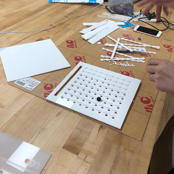 Underneath the laser cut board, there will be LEDs that light up when the game is complete.