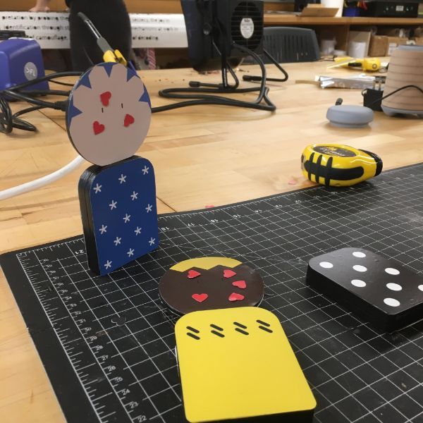 MFA Products of Design  second year Yangying was in the shop working on creating a polyamory themed board game. She used the laser cutter to make the pieces of the figurines and board and then put it all together using the acrylic solvent cement.