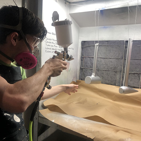 John Boran Jr. of  MFA Products of Design  came in today to use the department's brand new spray gun. He's in the spray booth to do some bluing coats on tools he designed for his thesis on Mars colonization.