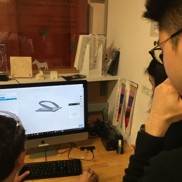 MFA Products of Design  first years Felix and Yufei are in the lab getting some 3d printing guidance from newly appointed Day Manager Chester Dols. They are building a wearable ambient noise cancelling machine for the future.