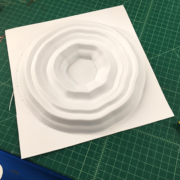 He used the  Shopbot  CNC Router to create a positive form out of MDF and then he vacuformed printed styrene on the Lab's  Formech  Vacuum Former for a plastic copy.