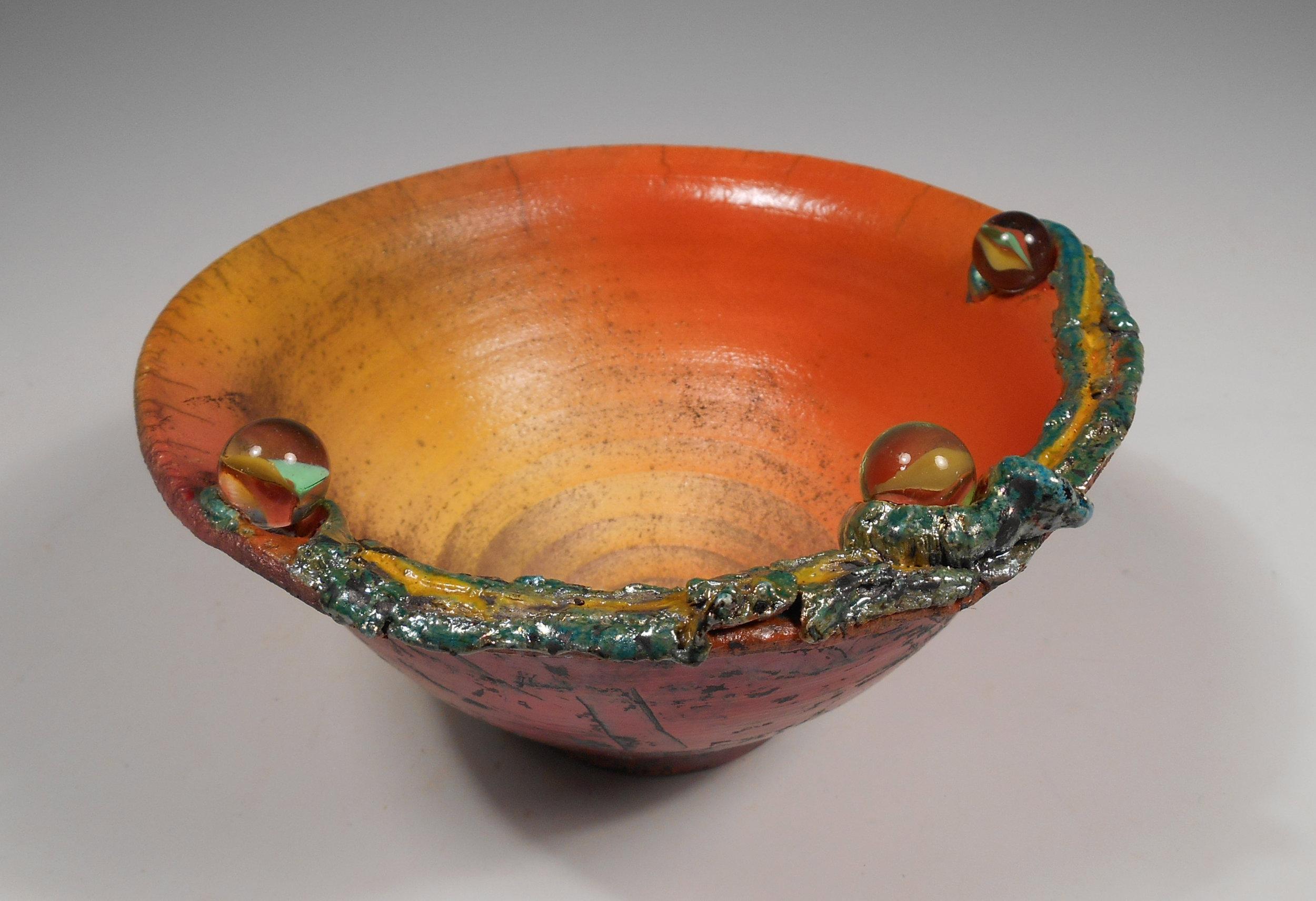 Corinne Cox raku bowl w marbles.jpg