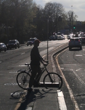 The cut-through made it easier to get from one side of the road to the other, but people on bikes didn't have protection from oncoming traffic. Photo courtesy of Calm Streets Boston
