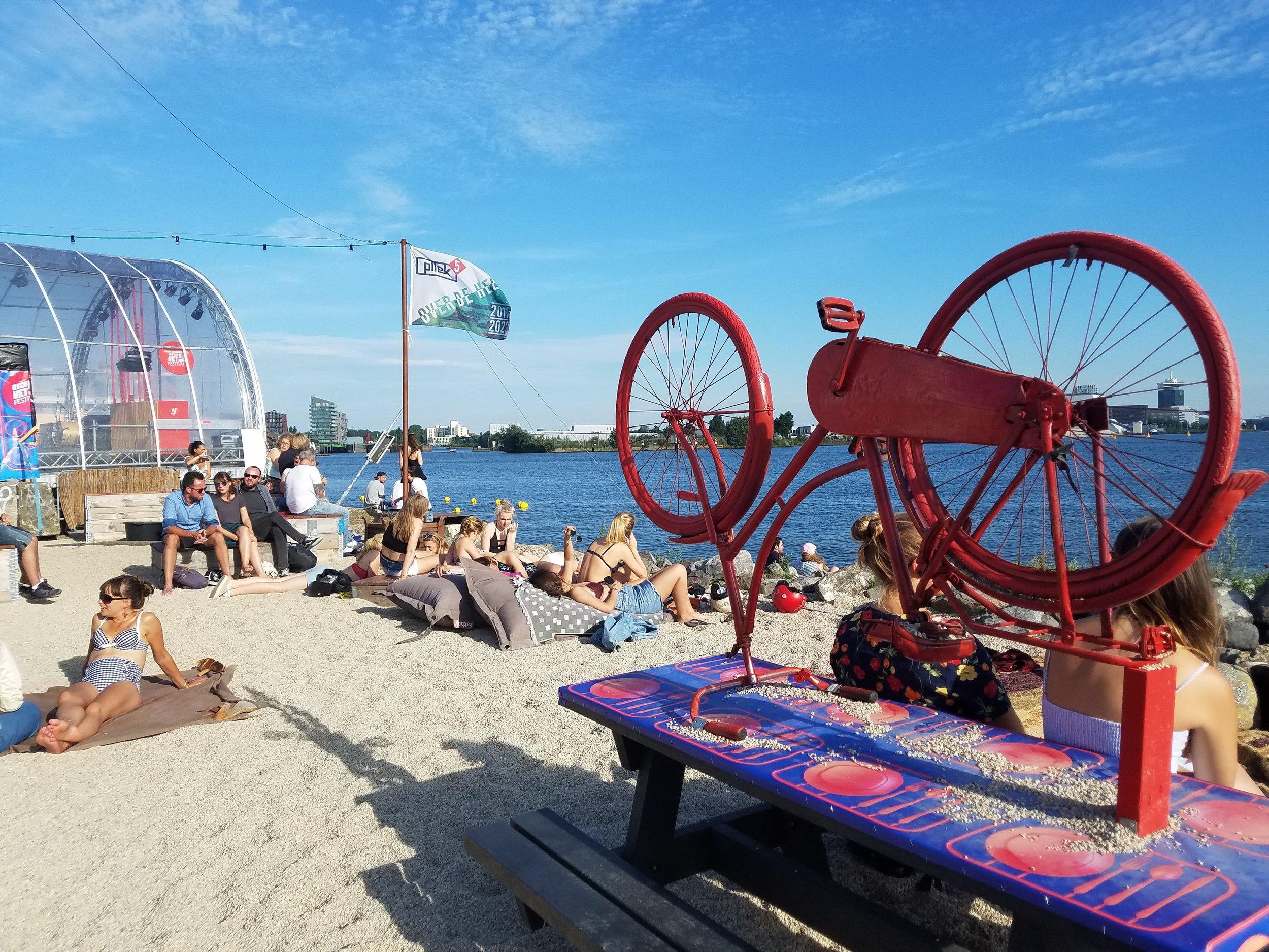 People enjoying the waterfront at Pllek