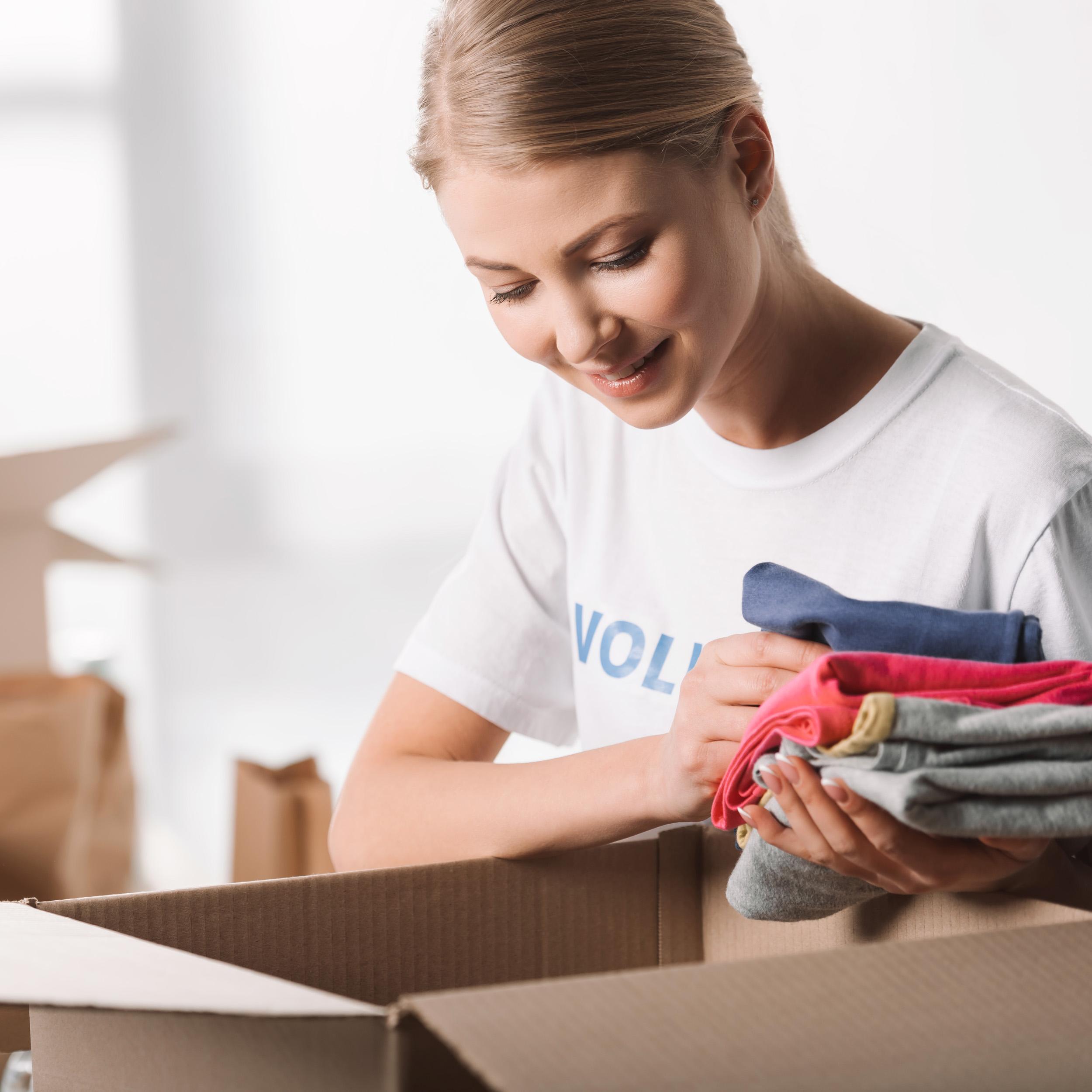 volunteer help sort clothes.jpg