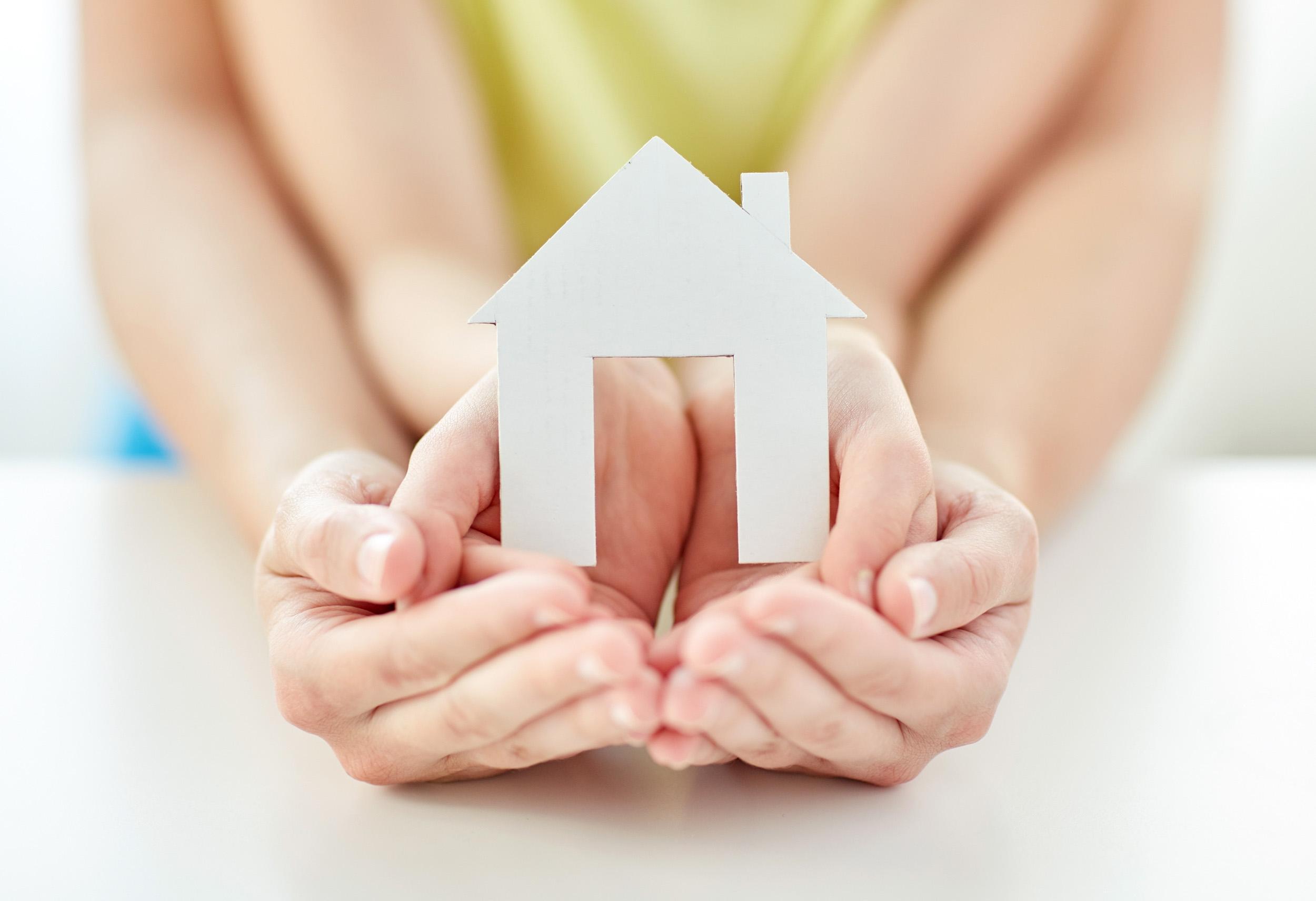 women hands paper house adoption grief care manitoba.jpg