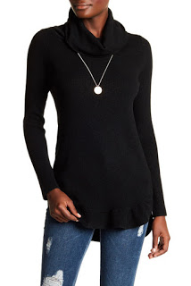 I love this sweater because of the neckline, and that you can layer a dress under it or wear it half tucked into a pair of trousers, or jeans like pictured above.