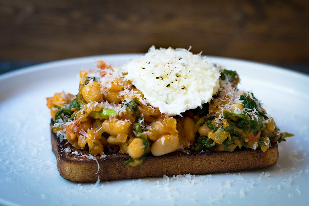 Tuscan Egg & Stewed Beans Breakfast Toast - Northern Beans, Kale, Onion, Tomato, Poached Egg, Parmesan