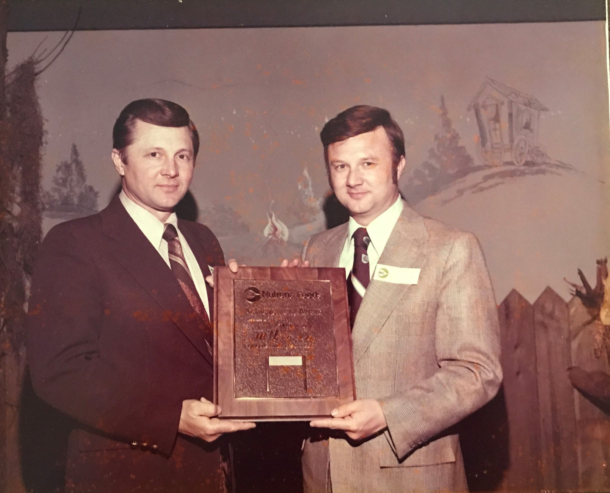 Gene (left) and Ronald (right) accept the Dealer Achievement award from Nutrena Feed in 1969. The brothers continued to win this award for 12 consecutive years.
