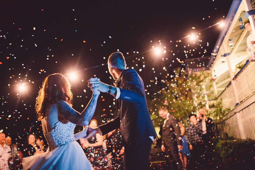Bride and groom's first dance under the stars with confetti