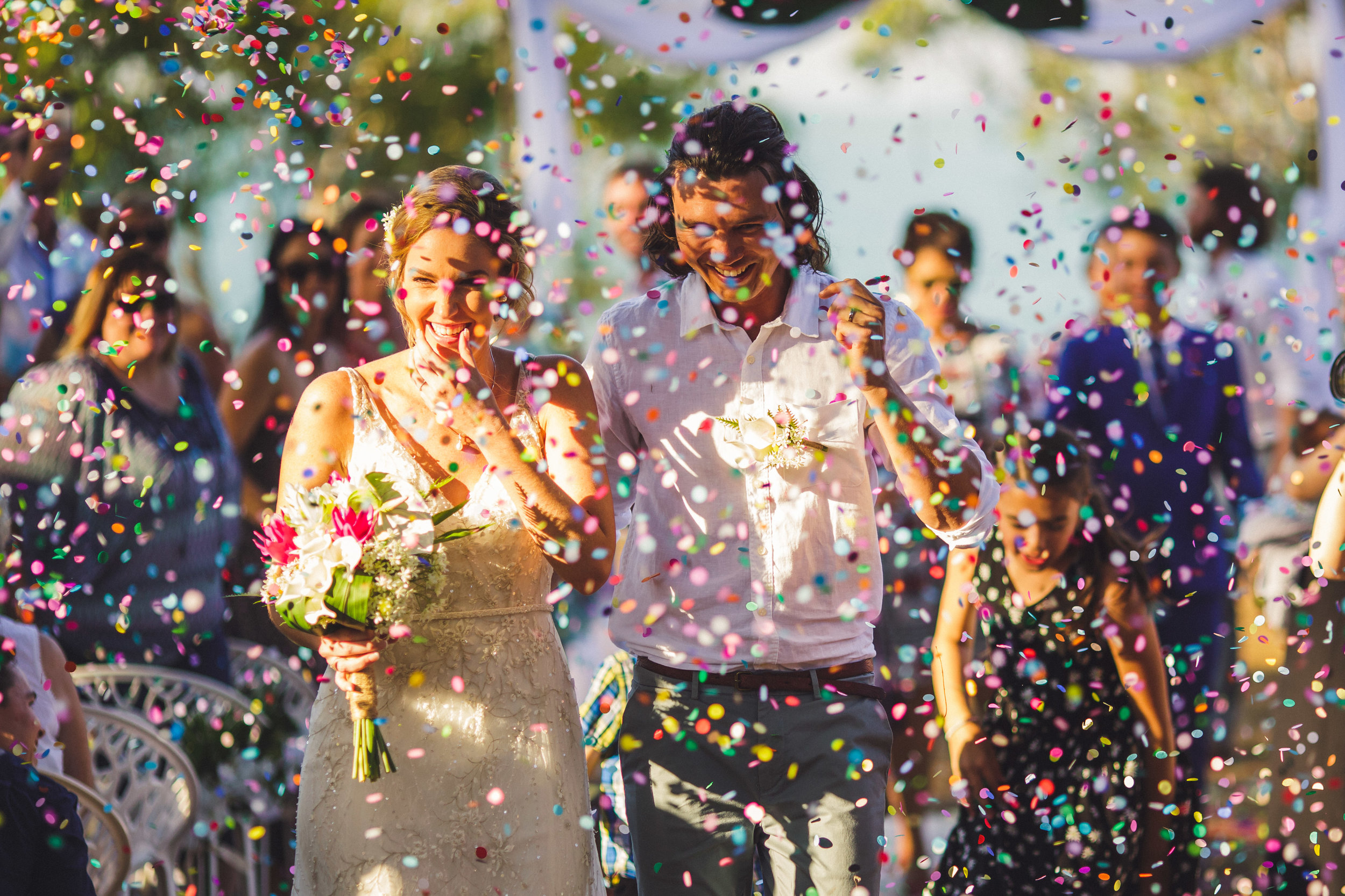 Bride and Groom just married with lots of confetti