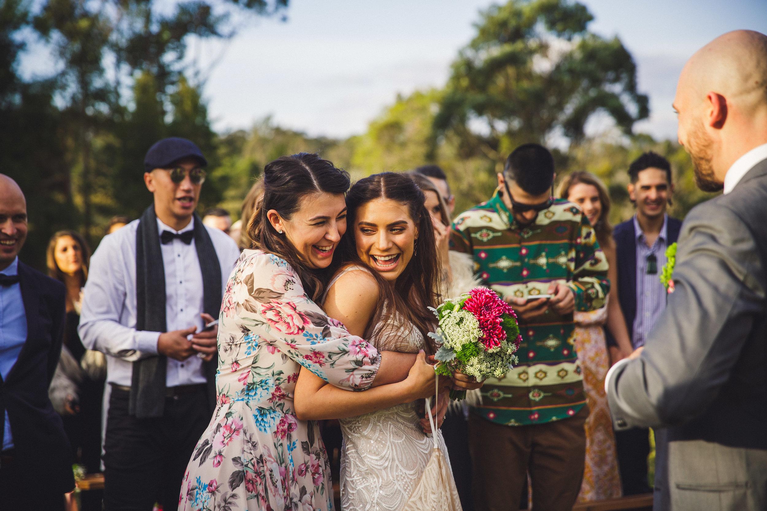 Guest congratulating bride at wedding at Ocean View Estates